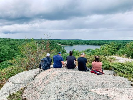 Group Overlooking Lake on a Cliff